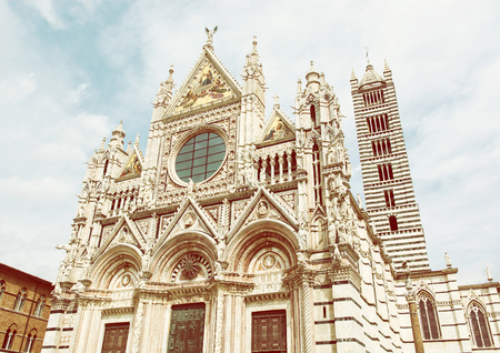 earliest: Siena cathedral is a medieval church in Siena, Italy, dedicated from its earliest days as a Roman Catholic Marian church. Yellow photo filter.