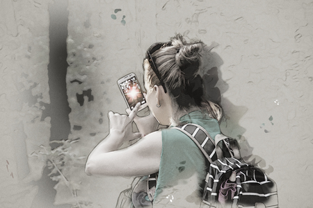 Young caucasian woman takes photo with smartphone in the forest. Sketch painting. Tourism theme. Retro photo filter. Stock Photo