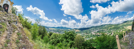 Panoramic photo of Banska Stiavnica from calvary hill, Slovak republic. Travel destination. Group of tourists. Beautiful landscape.