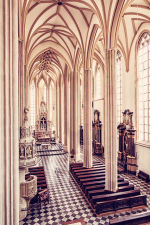 st: Interior of Church of St. James, Brno, Moravia, Czech republic. Religious architecture. Place of worship. Red photo filter. Editorial