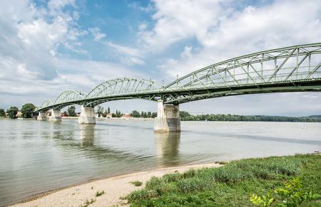 Maria Valeria bridge joins Esztergom in Hungary and Sturovo in Slovak republic across the Danube river. Transportation theme. Architectural scene. Stock Photo