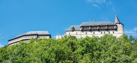huge tree: Gothic castle Karlstejn in Czech republic. Ancient architecture. Travel destination. Side view. Stock Photo