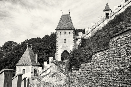 iv: Gothic castle Karlstejn in Czech republic. Ancient architecture. Travel destination. Walls and turrets. Black and white photo. Editorial