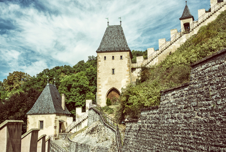 iv: Gothic castle Karlstejn in Czech republic. Ancient architecture. Travel destination. Walls and turrets. Old photo filter. Editorial