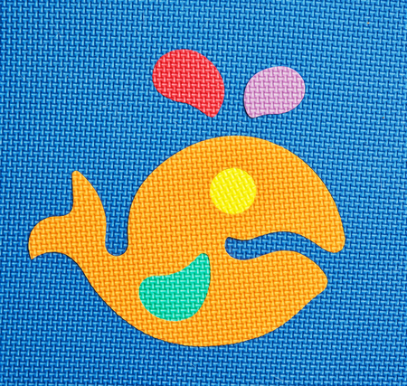 Colorful fish - baby rubber puzzle. Funny toy. Vibrant colors.
