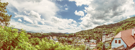 Panoramic photo of Banska Stiavnica with New castle and Old castle, Slovak republic. Travel destination. Beautiful urban landscape. Yellow photo filter. Editorial