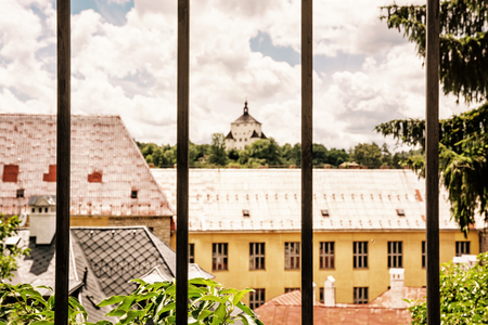 tin: New castle behind a metal fence, Banska Stiavnica, Slovak republic, Unesco. Architectural theme. Travel destination. Cultural heritage. Yellow photo filter.