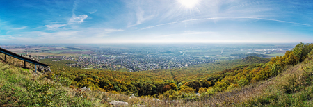 colourful lightings: Panoramic view of the Nitra city from Zobor hill, Slovak republic. Seasonal landscape. Autumn forest. Tourism theme.