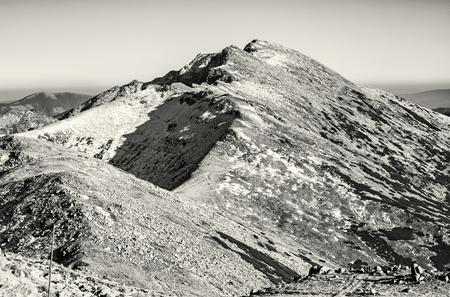 Footpath leading up the peak Dumbier, Low Tatras, Slovak republic. Hiking theme. Mountains scene. Black and white photo.