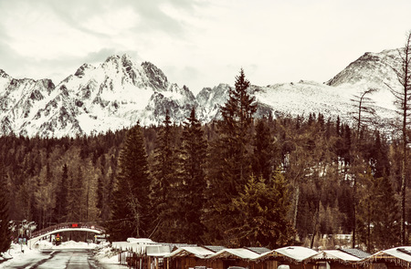 Strbske pleso area, center of winter sports, High Tatras, Slovak republic. Travel destination. Old photo filter.