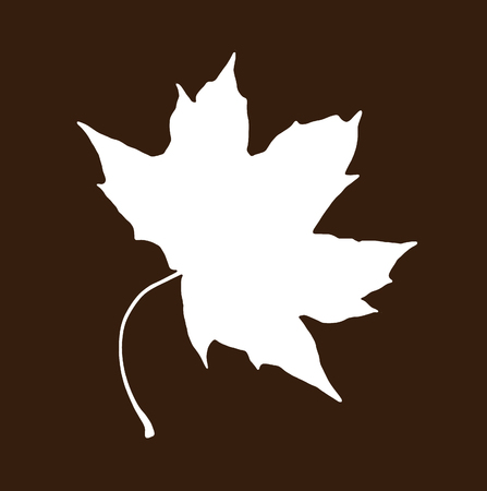 reverse: White shape of maple leaf on the brown background. Symbolic natural object.
