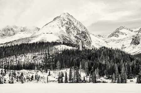Solisko peak with springboard for ski jumping, Strbske pleso, Slovak republic. Winter mountains. Seasonal natural scene. Black and white photo.