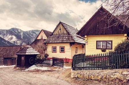Colorful wooden houses in Vlkolinec village, Slovak republic, Unesco. Cultural heritage. Travel destination. Folk architecture. Red photo filter.