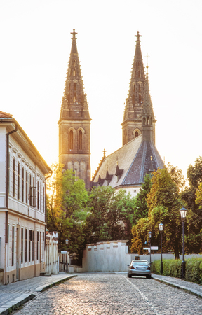 Beautiful basilica of Saint Peter and Saint Paul, Vysehrad, Prague, Czech republic. Sunset photo. Religious architecture. Travel destination. Yellow photo filter. Stock Photo