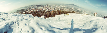 Snowy landscape with Nitra city, Slovak republic. Panoramic photo. Beautiful seasonal scene. Old photo filter. Stock Photo