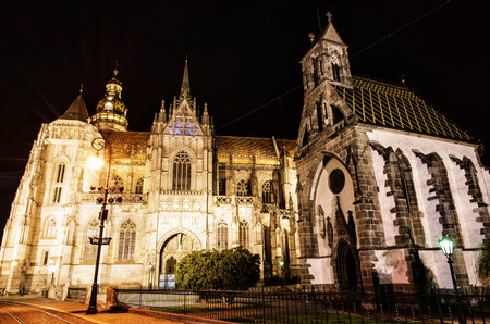 Spectacular St. Elisabeth cathedral and St. Michael chapel in Kosice, Slovak republic. Architectural scene. Night photo. Yellow photo filter.