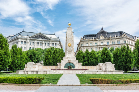 Soviet war memorial in Budapest, Hungary. Cultural heritage. Architectural theme. Historical object. Travel destination. Memorial place. Memorial, green trees and old buildings.