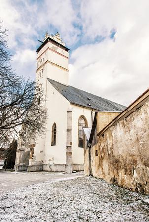 Basilica of the Holy Cross in Kezmarok city, Slovak republic. Religious architecture. Travel destination. Beauty photo filter.