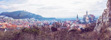 Panoramic photo of Mikulov with castle, holy hill and old town centre. Czech republic. Travel destination. Beauty photo filter. 写真素材