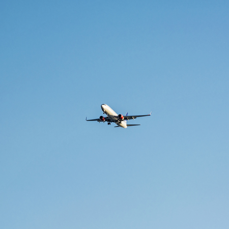 Aircraft is landing in the holiday destination. Summer vacation. Transporting theme. Stock fotó
