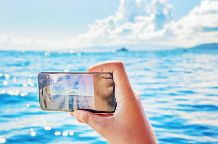 Smart phone mobile photography of cruise on the Adriatic Sea in Croatia. Summer vacation. Travel destination. Vivid photo filter.