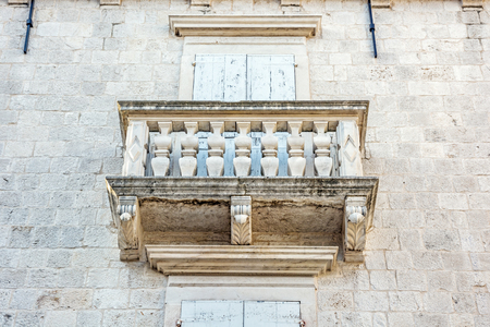 Balcony on the old house, Trogir, Croatia. Travel destination. Architectural theme.