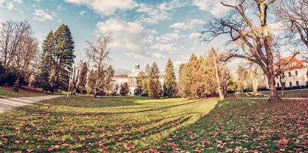 Topolcianky castle with park in autumn, Slovak republic. Panoramic photo. Travel destination. Retro photo filter.