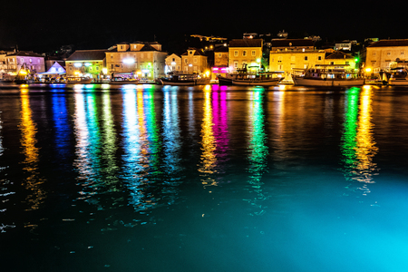 View of houses on Ciovo island, night colorful scene. Travel destination. Summer vacation.