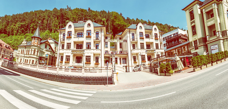 TRENCIANSKE TEPLICE, SLOVAKIA – JULY 25, 2018: Bridge of Glory in Trencianske Teplice, Spa resort in Slovak republic. Panoramic photo. Travelling theme. Artfilm international film festival. Yellow photo filter.