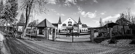 Historic building of national stud farm, Topolcianky, Slovak republic. Architectural theme. Travel destination. Panoramic photo. Black and white photo.