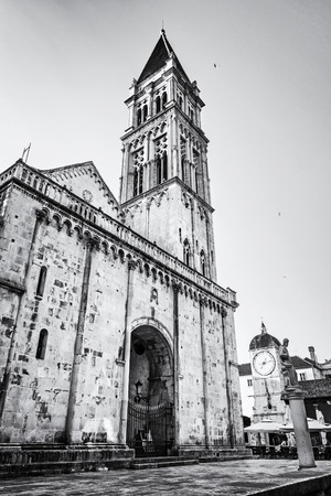 The Cathedral of St. Lawrence is a roman catholic triple-naved basilica constructed in romanesque-gothic in Trogir, Croatia. Religious architecture. Travel destination. Black and white photo. Stock Photo