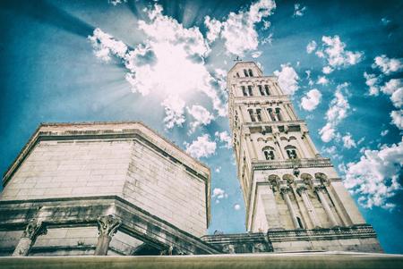 Cathedral of Saint Domnius in Split, Croatia. Religious architecture. Travel destination. Sun rays scene. Analog photo filter with scratches. Stok Fotoğraf