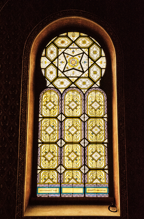 Artistic window in Spanish synagogue, Prague, Czech Republic. Religious architecture. Yellow photo filter. Editorial