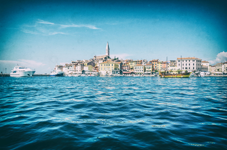 Historic town of Rovinj with Church of St. Euphemia, Istria, Croatia. Sea and town. Travel destination. Analog photo filter with scratches.