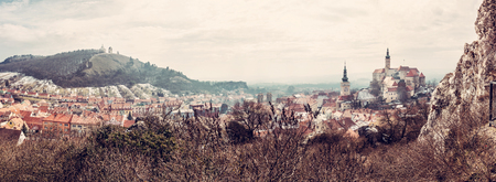 Panoramic photo of Mikulov with castle, holy hill and old town centre. Czech republic. Travel destination. Beautiful place. Red photo filter.