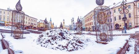SNP square in Banska Bystrica, Slovak republic. Winter scene. Travel destination. Purple photo filter. Reklamní fotografie