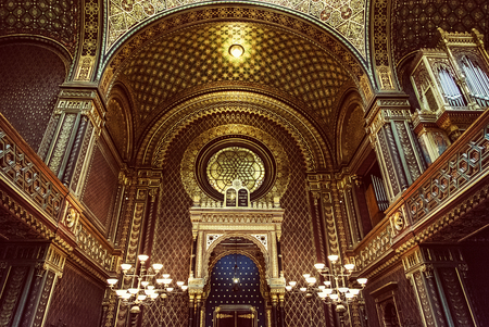 Interior of Spanish synagogue, Prague, Czech Republic. Religious architecture. Red photo filter.