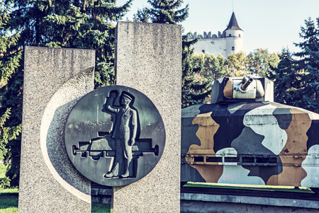 Replica of armored train Hurban with sculpture located near castle in Zvolen city, Slovak republic. World War II memorial. Blue photo filter. Sajtókép