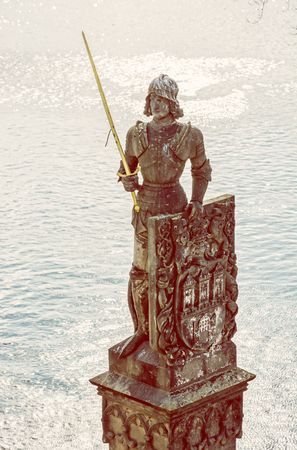 Ancient statue of Bruncvik knight, Charles bridge, Prague, Czech republic. Architectural scene. Travel destination. Yellow photo filter.