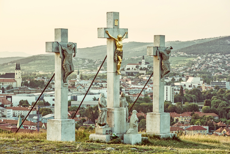 Calvary with castle in Nitra city, Slovak republic. Religious place. Sunset scene. Cultural heritage. Travel destination. Old photo filter. Banque d'images