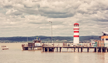 Lighthouse in Podersdorf am See, lake Neusiedler See, Burgenland, Austria. Travelling theme. Red photo filter.