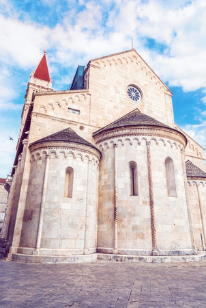 Cathedral of St. Lawrence is a roman catholic triple-naved basilica constructed in romanesque-gothic in Trogir, Croatia. Religious architecture. Travel destination. Red photo filter. Stock Photo