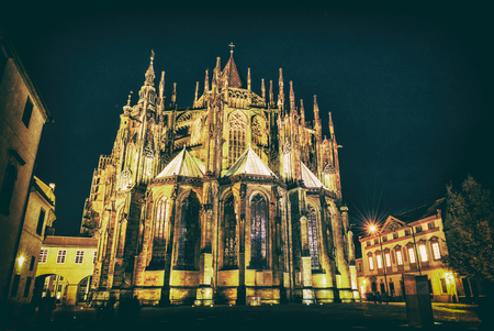St. Vitus Cathedral in Prague, Czech republic. Night scene. Travel destination. Religious architecture. Analog photo filter with scratches.