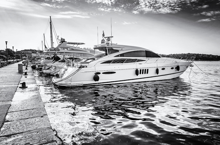 Yachts in port, Porec, Croatia. Summer vacation. Travelling theme. Mediterranean Sea. Black and white photo.