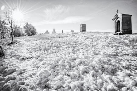 Calvary in Nitra city, Slovak republic. Religious place. Winter scene. Cultural heritage. Travel destination. Snow and sunny. Black and white photo. Stock Photo