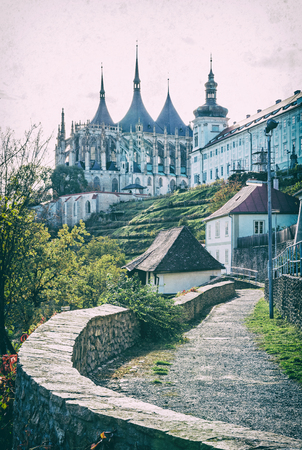 St. Barbaras Church and Jesuit College in Kutna Hora, Czech republic. Religious architecture. Travel destination. Analog photo filter with scratches.