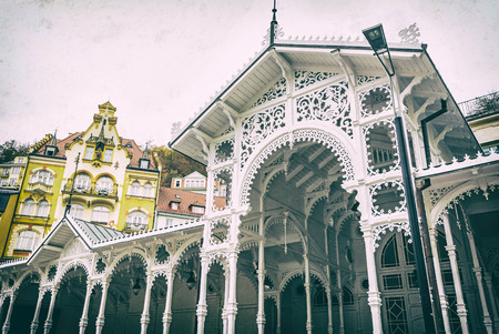 Typical architecture in Karlovy Vary, Czech republic. Travel destination. Analog photo filter with scratches. 写真素材