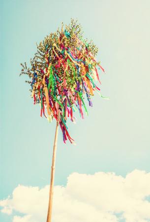 Looking up at may pole. Symbolic object. Retro photo filter. Stock Photo