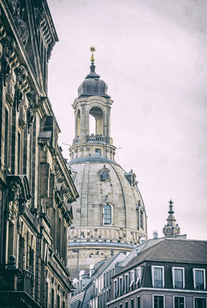 Frauenkirche in Dresden, Germany. Religious architecture. Travel destination. Analog photo filter with scratches.