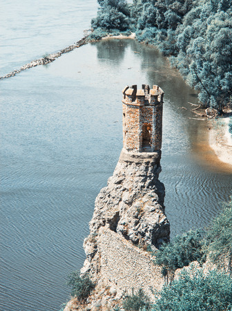 Maiden tower of Devin castle, Slovak republic, Central Europe. Teal and orange photo filter. 免版税图像